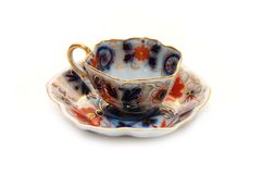 Old teacup with a saucer Royalty Free Stock Photo