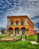 Old Teague Hotel in HDR. The old Teague Hotel in Teague Texas. With blue skies and white clouds royalty free stock images