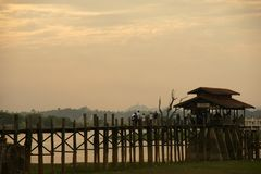 Old teak bridge near Mandalay in Burma, Asia. Old teak bridge before sunset near Mandalay in Burma, Asia Stock Image