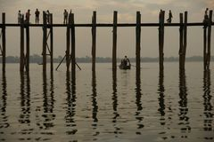Old teak bridge near Mandalay in Burma, Asia. Old teak bridge before sunset near Mandalay in Burma, Asia Stock Photos
