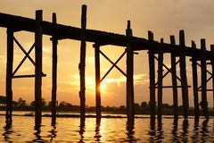 Sunset, Old teak bridge near Mandalay in Burma, Asia. Old teak bridge during sunset near Mandalay in Burma, Asia Royalty Free Stock Image