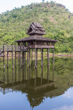 Old teak church. In the small lake which in front of the mountain Stock Photography