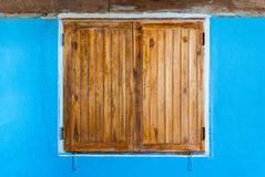 Old Teak Wood Window on Blue Wall Royalty Free Stock Images