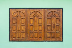 Old Teak Wood Window on Green Wall Stock Images