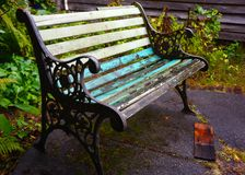 Empty weathered wooden bench Stock Image