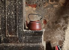 Old teapot in an abandoned house Stock Photography
