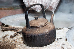 Old teapot boils for Boiling rock salt Royalty Free Stock Photo