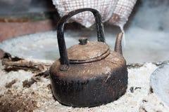 Old teapot boils for Boiling rock salt Royalty Free Stock Photo