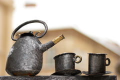 Old teapot with cups Royalty Free Stock Image