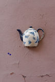 Old teapot on facade of building in Vilnius, Lithuania. Royalty Free Stock Photography