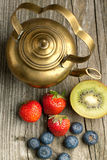 Old teapot with fruits Royalty Free Stock Photography