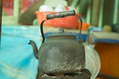 Old teapot in soot, boil water, soot. Old teapot in soot, boil water, black soot royalty free stock image