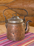 Old teapot on the table. Stock Photo