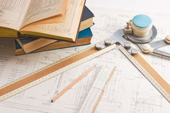 Old technical drawings. Old drawing apparatus and book stock image