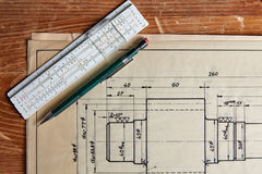 Old technical plan with pen on old table Royalty Free Stock Photo