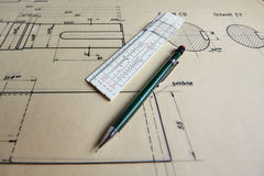Old technical plan with pen on old table Stock Photos