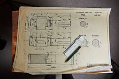 Old technical plan with pen on old table Stock Photo