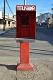 Old technology empty telephone booth San Felipe, Baja, Mexico. December 25th 2017, Christmas Day deserted street with abandoned telephone booth with pay phone Royalty Free Stock Images