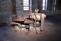 Old Technology Industrial Machine. An old machine in a disused industrial ship building setting on Cockatoo Island, Sydney Australia Stock Images