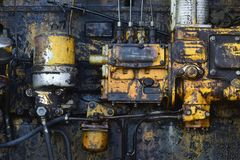 Old technology, vintage. Industry, engineering, machine. Factory, manufacture equipment. Device tool gear Machinery with oil dirt on grunge metal background stock photography
