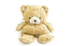 Old teddy bear with bow isolated. Stock Images