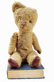Old teddy bear and old book Royalty Free Stock Image