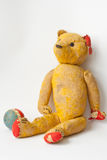 Old Teddy Bear. Very old teddybear tattered and broken down sitting beside a rubber ball that is deteriorating Royalty Free Stock Image
