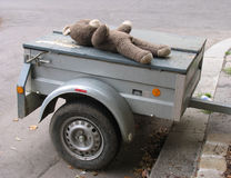 Old teddy on trailer. Vintage teddy on trailer waiting to be sold on a fleamarket Royalty Free Stock Photography