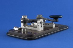 Old telegraph key. Over blue background Stock Photography