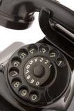 Old telephon. Black retro telephon on white Royalty Free Stock Photos
