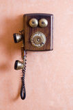 Old telephone. On the wall Stock Photo