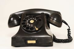 Old telephone. Very old brown/black telephone Stock Images
