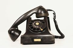 Old telephone. Very old brown/black telephone Stock Photo