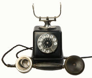 Old telephone 2. Old telephone isolated on white background, handset down, studio lights Stock Image