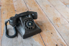 Old telephone. With wood background Royalty Free Stock Photos