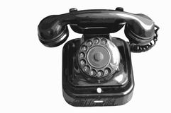 Old telephone. Old black telephone - isolated Stock Images