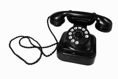 Old telephone. Old classic black telephone on white background Stock Image