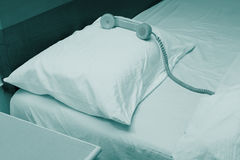 Old telephone on the bed Royalty Free Stock Images