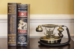 Old telephone and books Royalty Free Stock Photos