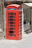 Old Telephone Booth. Red telephone booth in Valletta, Malta. The Maltese heritage from the British Empire Stock Images