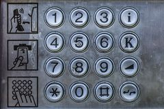 Old telephone booth metal numbers and user manual. Rustic and Old telephone booth metal numbers and user manual. Close up, retro and vintage concept Royalty Free Stock Photo