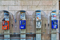 Old telephone booths on the wall of the house in the orthodox qu Royalty Free Stock Photos