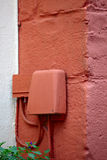 Old telephone box. A old telephone box on a sandstone facade, small city Saarburg, Rheinland-Pfalz, Germany Royalty Free Stock Photography