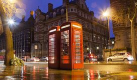 Old telephone cabins in London city. Night scene Royalty Free Stock Photos