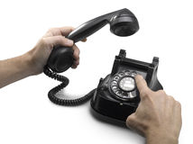 Old telephone dial with hands.(clipping path) Royalty Free Stock Image