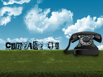 Old telephone in grass Royalty Free Stock Photo