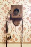 Old Telephone with hand crank. Hangs on decoration wall Stock Image