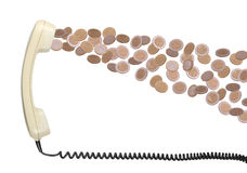 Old telephone headset with coins Royalty Free Stock Photography