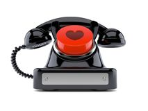 Old telephone with heart push button. On white background Stock Photos
