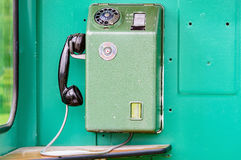 Old telephone. An old telephone from inside a telephone booth from the 1970s. The mobile phone of the old age. This is a Swedish model with the old emergency or Royalty Free Stock Photos